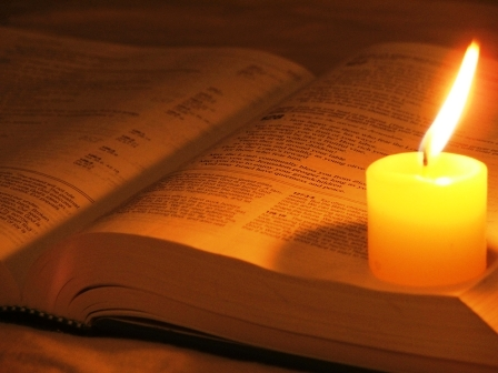 candle on bible